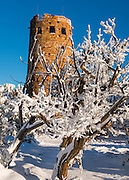 Winter at the Desert View Watchtower in Grand Canyon National Park. A fresh blanket of snow is on the groud and the trees are covered in Rime ice.