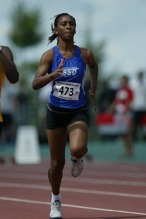 (Sherbrooke, Quebec -- 8 Aug 2009)  Tameran Defreitas of South Simcoe Dufferin T.F competes in 100m heats at the 2009 Royal Canadian Legion National Youth track and field championships. Photograph copyright Sean Burges / Mundo Sport Images  2009.