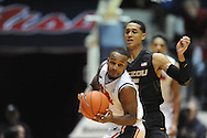 "Mississippi's Derrick Millinghaus (3) vs. Missouri's Jordan Clarkson (5) at the C.M. ""Tad"" Smith Coliseum in Oxford, Miss. on Saturday, February 8, 2014. (AP Photo/Oxford Eagle, Bruce Newman)"