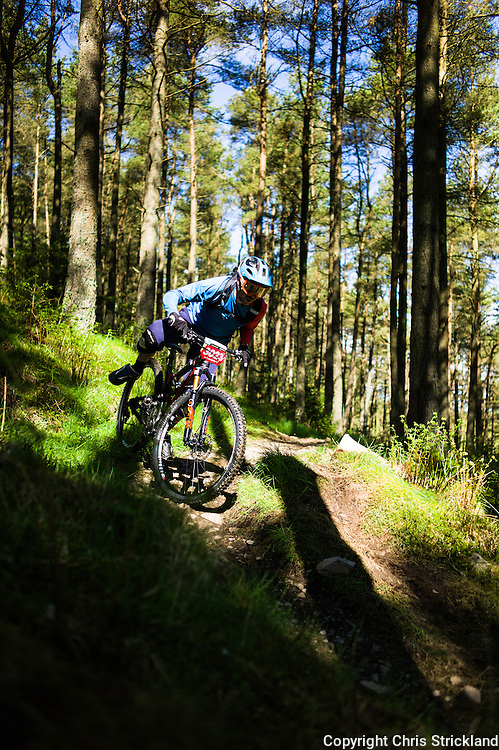 Innerleithen, Tweed Valley, Scotland, UK. 30th May 2015. Crawford Carrick-Anderson nearly takes a tumble at The Enduro World Series Round 3 taking place on the iconic 7Stanes trails during Tweedlove Festival. Mountain bikers come up against eight stages across two days, with an intense 2,695 metres of climbing over 93km. As well as the physicality of the liaisons, the stages themselves are technical, catching many off guard.