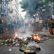 Protestors in Mitropoleos Str are watching the police operations in Syntagma Sq. The fire was lit to protect people from tears gas that was thrown extensively by riot police in Athens, June 29, 2011