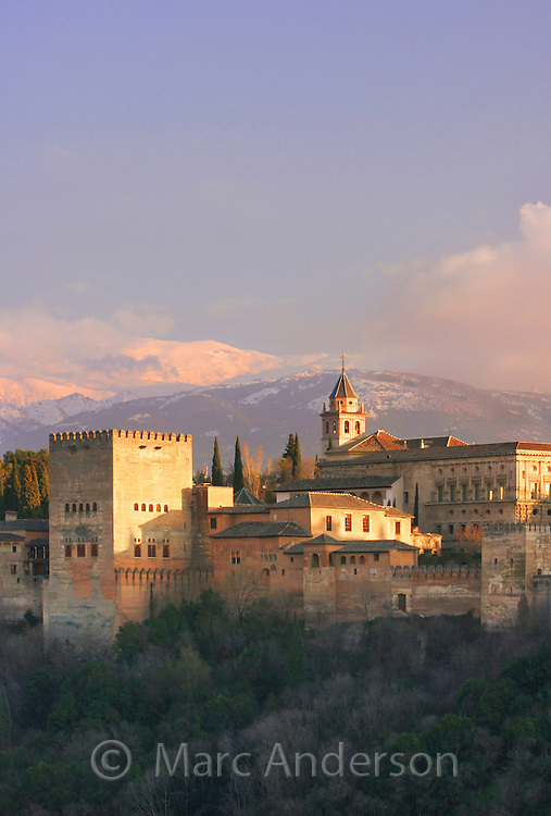 The Alhambra Palace with the Sierra Nevada mountains in the background, Granada, Spain