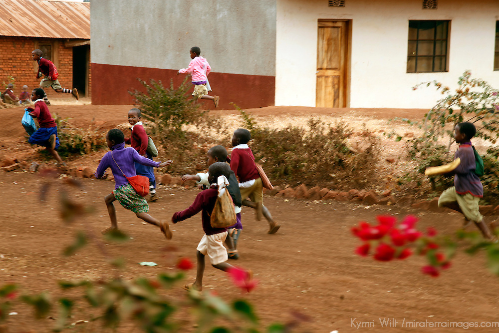 Africa, Tanzania, Karatu. Tloma Primary School Children running for lunch break n Karatu, Tanzania.