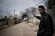 SYRIA - Al Qsair Syrian civilian shows the smoke of burning tires in a street close to combats between Free Syrian Army and Al Asad forces in Al Qsair, on February 23, 2012. ALESSIO ROMENZI