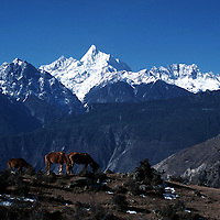 """MEILI MOUNTAIN, DECEMBER 17, 2000: a view of Mt. Meili ( Mt. Meilixue ) , the highest peak in Yunnan province, in Deqin county, Yunnan province , December 17, 2000..Mt. Meili is the highest peak in Yunnan province and according to supporters from Deqin county, it's a """"proof"""" that the 'real"""" Shangri-La is located in deqin county. The fictuous Mt. Karakal which is described in James Hilton's Lost Horizon, alledgedly is modelled on Mt. Meili in Yunnan province.."""