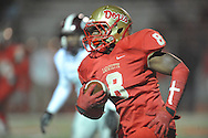 Lafayette High's Tyrell Price (8) runs vs. Greenwood in MHSAA Class 4A playoff action in Oxford, Miss. on Friday, November 15, 2013. Lafayette won 7-0.