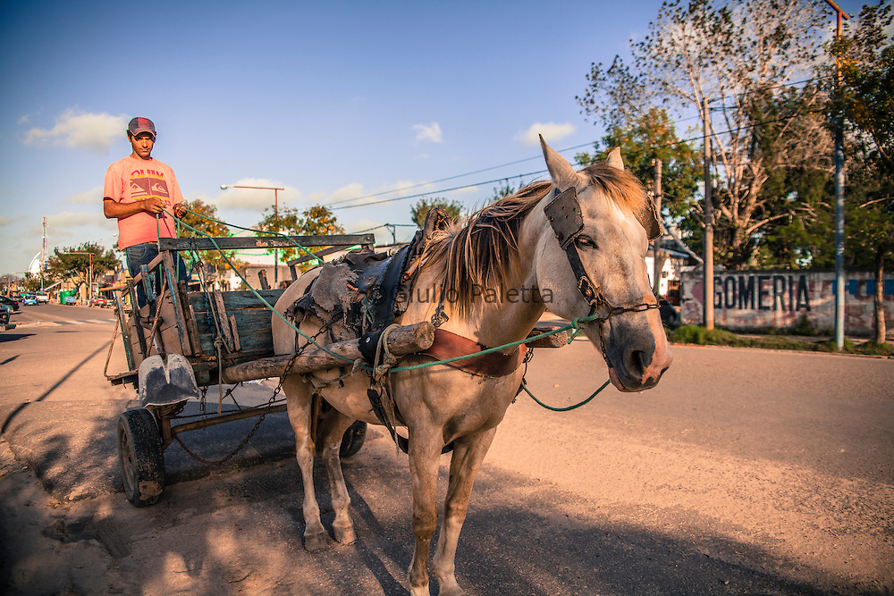 Edison (Uruguayan) during a break from work, right in the middle of the international division line between Brazil and Uruguay in the town of Chui (Brazilian side) - Chuy (Uruguayan side). To make a living, Edison transports furnitures and everything his horse is able to carry. This job is still surviving and quite common in Chui