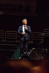 ANAHEIM, CA - JUN 9: Italian tenor Andre Bocelli performed Granada, New York, La Boheme, LaTraviata among others keeping audience mesmerized at the Honda Center in Anaheim, CA. The magical night included producer David Foster on Piano, Violinist Caroline Campbell, American Idol Season 3 winner Soul Singer Fantasia, Cuban Soprano Maria Aleida and Orchestra Conductor Eugene Kohn. Producer David Foster addresses the audience for being late to his performance due to LA traffic. All fees must be agreed prior to publication, Byline and/or web usage link must  read  PHOTO: SilvexPhoto.com