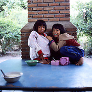 """Akha childred having their lunch at the premises of the NGO """"Children of the Golden Triangle"""", in Chiang Rai province"""