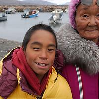Inuit family. Coastal Inuit community of Arctic Bay. Lancaster Sound. HIgh Arctic. Baffin Island.<br />
