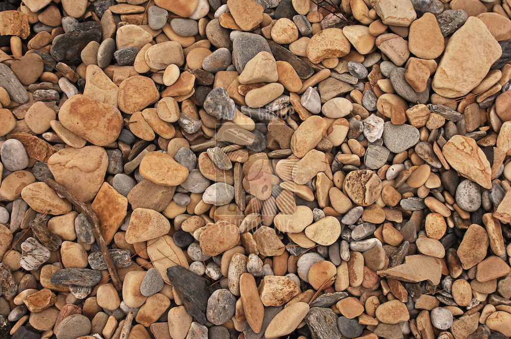 assorted pebbles on a beach on the