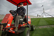 Australian Parliment House Canberra. Brock Weston from Landscape services mows the lawn on the roof of Parliament House.