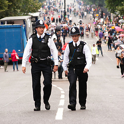 London, UK - 27 August 2012: two policeman walk at the annual Notting Hill Carnival.