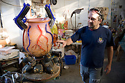 Tijuana Mexico ..glas blowing artist Einar De La Torre at his studio near Ensenada. He works with his brother Jamez de la Torre...While working on this long term project 'La Frontera' I want to examine the cultural and humanitarian activities on both sides of a border that keeps the United States and Mexico apart with a wall of steel already 600 miles long. The turf wars of drug cartels, arms trafficking and rampant kidnappings turned cities like Tijuana into some of the most dangerous places on earth. Despite the violence many brave artists, photographers, architects, poets, humanitarians, teachers etc live and work in the shadow of the wall on both sides and have a positive influence on this region; they are the focus of my long term project along the border. (Over time I plan to cover the entire length from the Atlantic to the Pacific, these images were taken in and around Tijuana).© Stefan Falke