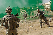 The U.S. Army uses concealment smoke to mask their movements as they conduct a joint operation with the Iraqi police in Baqubah, Iraq, on Mar. 31, 2007.