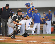 Oxford High's Brooks Krouse (9) scores in the first inning vs. Starkville in MHSAA CLass 5A playoff action at Oxford-University Stadium in Oxford, Miss. on Monday, May 6, 2013. Oxford High won 3-1 to win the best-of-three series.