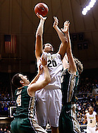 WEST LAFAYETTE, IN - DECEMBER 29: A.J. Hammons #20 of the Purdue Boilermakers shoots the ball against Matt Rum #4 of the William & Mary Tribe and Tim Rusthoven #22 of the William & Mary Tribe at Mackey Arena on December 29, 2012 in West Lafayette, Indiana. (Photo by Michael Hickey/Getty Images) *** Local Caption *** A.J. Hammons; Matt Rum; Tim Rusthoven