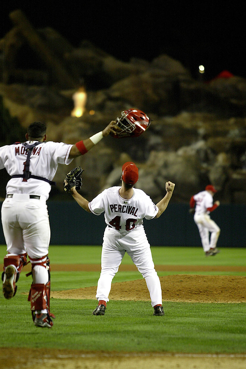 ANAHEIM, CA - 2002: Troy Percival of the California Angels celebrates after the Angels defeated the San Francisco Giants in Game 7 to win the 2002 World Series at Edison Field in Anaheim, California on October 27, 2002. (Photo by Ron Vesely)