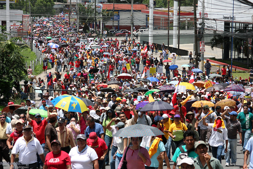 "Tegucigalpa, Honduras. July 4th, 2009. Thousands of people march through the streets of Tegucigalpa in a peaceful protest to the Coup d'Etat that forcibly removed President Manuel ""Mel"" Zelaya on June 28th, 2009."