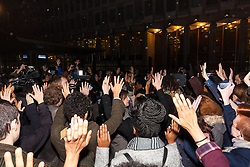 "London, November 26th 2014. A vigil for teenager Mike Brown who was shot dead by a policeman in Ferguson, Missouri this year, takes place outside the US embassy in London. Anti-racism and human rights campaigners called the 'emergency' protest following a court verdict that clears Police Officer Darren Wilson of murder. PICTURED: The crowd makes a ""Hands-up! Don't shoot!"" gesture in protest against police shootings."