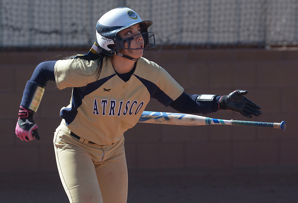 gbs040417o/SPORTS -- Aristco Heritage's Jaelynn Vialpando watches her hit that was a double in the first inning of the game at West Mesa on Tuesday, April 4, 2017. (Greg Sorber/Albuquerque Journal)