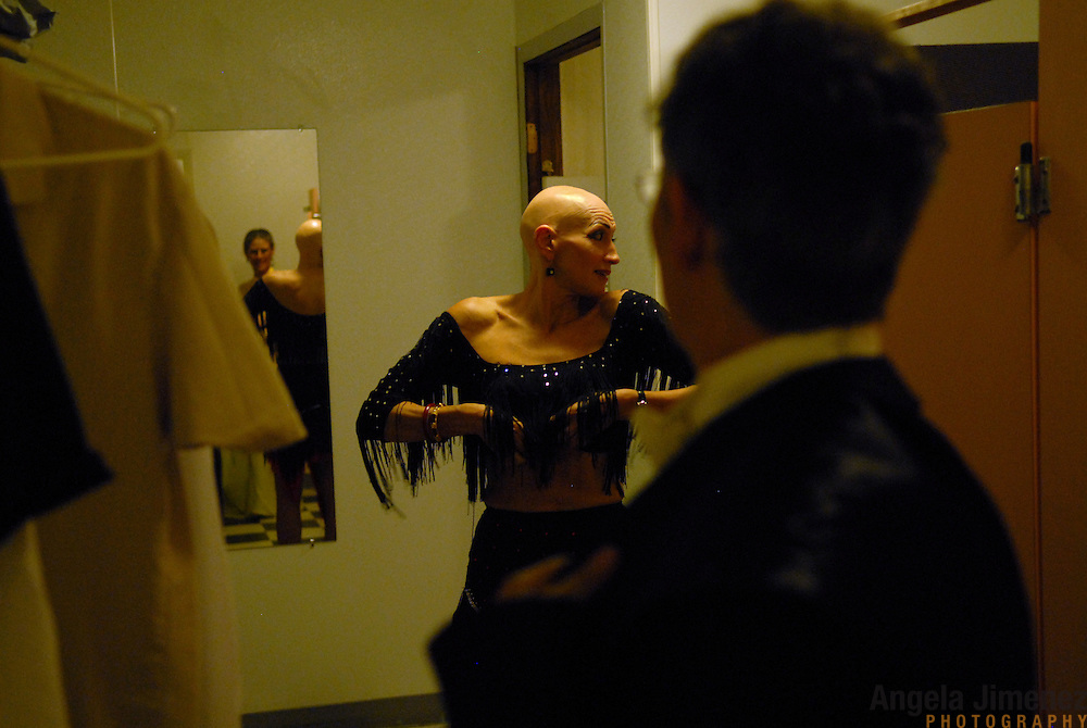 Female same-sex ballroom dancers Winter Held, of Oakland, California, from left, reflected in mirror, Zoe Balfour, also of Oakland, and Barbara Zoloth, of Berkeley, California, get dressed in the women's restroom before competing at the USADSF (United States Alternative Dancesport Federation) Same-Sex Ballroom Championships at Dance Orlando in Orlando, Florida on June 2, 2007...Nine male and female couples from around the country competed in the event, which was the 3rd annual United States championship contested in this sport: the first two championships were held in Sacramento, California in 2005 and 2006. This was the first same-sex ballroom competition ever held in Florida. ..Same-sex ballroom dancing is a new sport which is growing and developing in the United States, but it has a longer history in Europe, where events have been held for over two decades.  ..