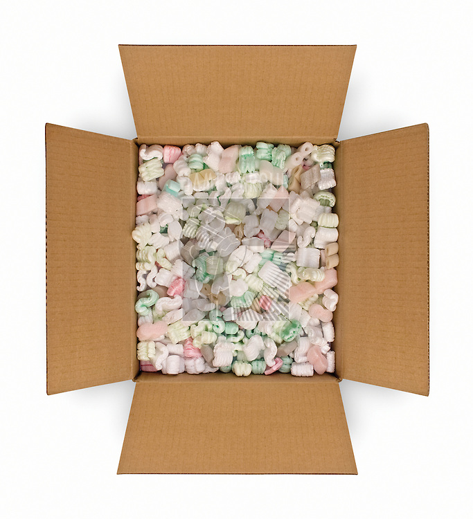 Opened cardboard box filled with styrofoam peanuts