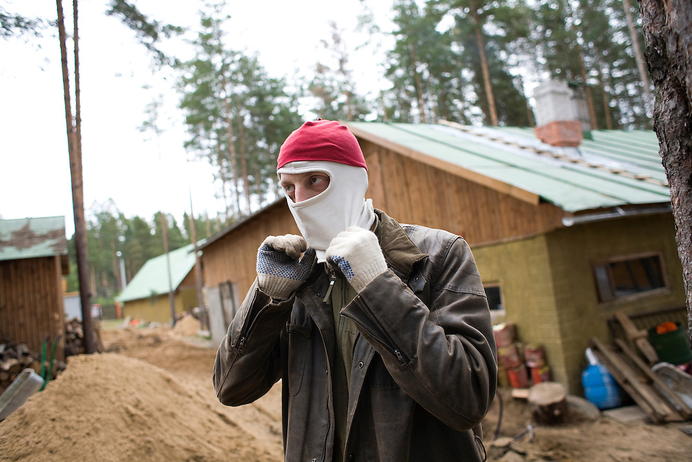Valera, a former drug user who is now in a rehabilitation program run by the orthodox church, puts on a face mask at the organization's live-in retreat in Sapernoe, Russia, on Saturday, September 15, 2007. About a dozen people at a time live and work at the remote farm, about two hours from St. Petersburg, for a free one year course of treatment.
