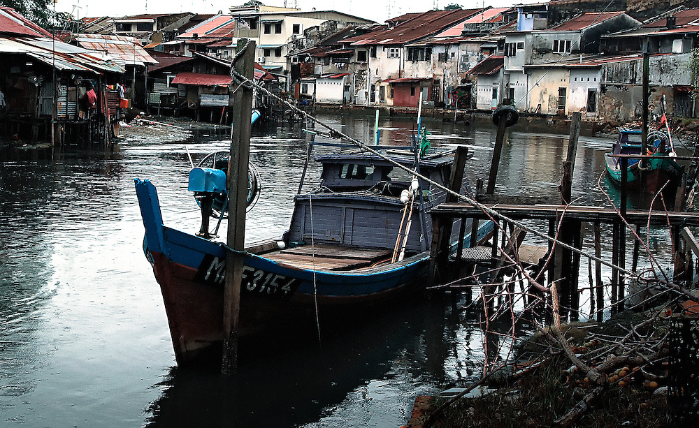 Boats moored in Sangai Melaka river running through the historical city of Melaka, Malaysia