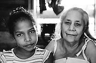 Young girl with her sick grandmother on a farm in Vega Yumuri, near La Maquina, Guantanamo Province, Cuba.