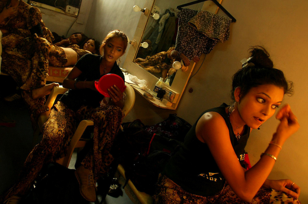 Dancers put on their make up as they prepare for their next dance routine in Bombay, India Dec 10, 2004. Bombay's film industry may be the most prolific in the world, but unlike it's American counterpart, much of the work is done on a shoestring. The city churns out hundreds of films a year on its celluloid production line.
