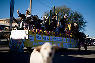A float makes its way through the crowd as part of a parade celebrating the annual rodeo and carnival on the Tohono O'odham Native American reservation in Sells, Arizona, on Saturday, Feb. 2, 2008. The annual rodeo has been taking place for 70 years and is the largest Indian rodeo in Arizona.