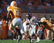 Ole Miss running back Jeff Scott (3) is tackled by Tennessee linebacker Herman Lathers (34) in a college football game at Neyland Stadium in Knoxville, Tenn. on Saturday, November 13, 2010. Tennessee won 52-14.