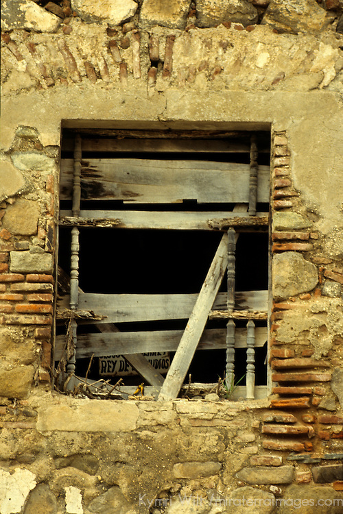 Central America, Guatemala, Antigua. A dilapidated window with makeshift shutters in Antigua, Guatemala.