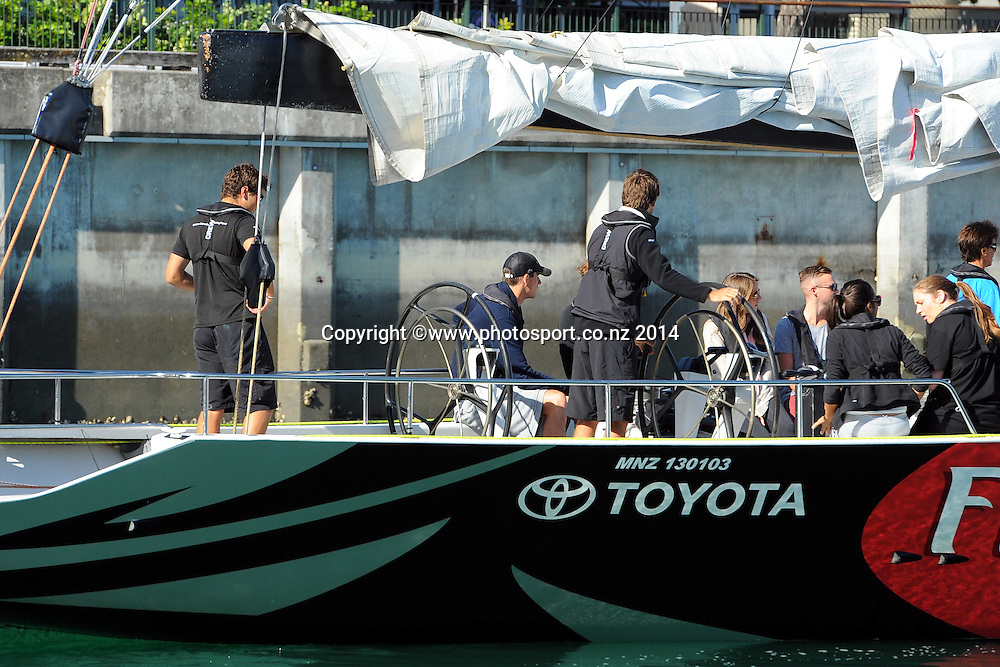 John Isner of the USA on board a SailNZ yacht at the Auckland Viaduct on Day 2 of the  Heineken Open Day 2. ASB Tennis Centre, Auckland, New Zealand. Tuesday 7 January 2014. Photo: Chris Symes/www.photosport.co.nz