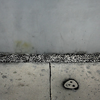MIAMI, FL -- January 19, 2008 -- A spray painted stencil dots the sidewalk outside of The Rubell Family Collection in the Wynwood Art District in Miami, Fla., on Saturday, January 19, 2008.  The collection is expansive in a 45,000 sq. ft. former D.E.A. confiscated-goods warehouse with contemporary works collected by the Rubell family since the 1960's.
