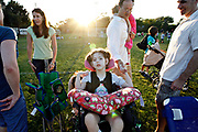 MELISSA LYTTLE       Times<br /> SP_351237_LYTT_TWINS_2 (March 16, 2012, Clearwater, Fla.) While Olivia Scheinman, 7, and her parents sat on the sidelines cheering Hailey  on during her soccer game, a family approached and complimented Olivia's wheelchair saying their daughter Olivia had the same one. The moms Allison Scheinman and Erica Reger, left, bonded over both having daughter's with disabilities named Olivia, while the dad's Jon Scheinman and Craig Reger bonded over having daughters playing soccer. The Regers recently moved to the area from New York, and their daughter Cassandra, 8, just joined Hailey's soccer team. The families shared their thoughts about therapy, schools and neighborhoods and exchanged phone numbers to keep in touch. Holding his daughter Olivia, 7, in his arms, Craig Reger takes Olivia Scheinman's hand in his and tells her how nice it was to meet her, before the families parted ways for the evening.  [MELISSA LYTTLE, Times]
