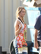July 1st 2010 Los Angeles, CA. ***EXCLUSIVE*** Shia LaBeouf and Rosie Huntington-Whiteley walk to the set of Transformers 3 to film a scene together. Rosie is wearing a funny kitchen apron with rose flowers and President Obama. Photo by Eric Ford 818-613-3955 info@onlocationnews.com