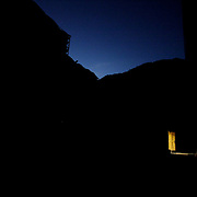 In late evening, light spills out of an open door on Forward Operating Base Bostick, Kunar Province of Eastern Afghanistan.