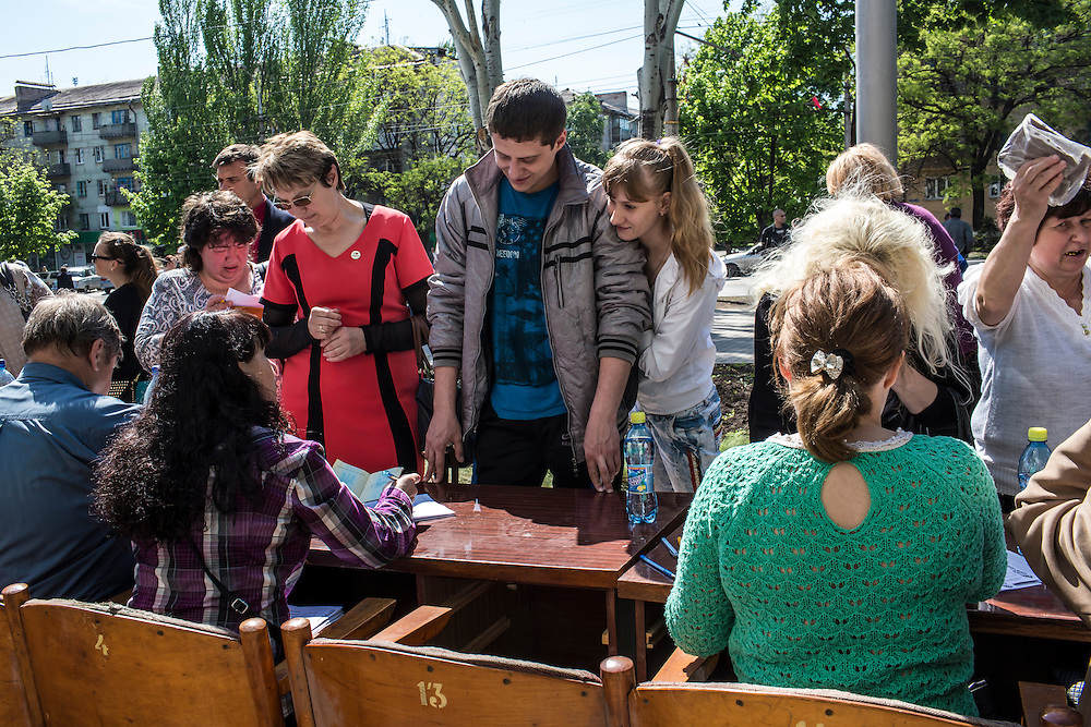 MARIUPOL, UKRAINE - MAY 11: People check in before voting at a polling station on May 11, 2014 in Mariupol, Ukraine. A referendum on greater autonomy is being held after pro-Russian activists took over at least ten cities in the eastern part of the country. (Photo by Brendan Hoffman/Getty Images) *** Local Caption ***