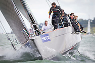 Jolt 2, racing in IRC class 0, competing on the opening day of Aberdeen Asset Management Cowes Week. The event began in in 1826 and plays a key part in the British sporting summer 'season'. It now stages up to 40 daily races for around 1,000 boats and is the largest sailing regatta of its kind in the world with 8,500 sailors competing.<br /> Picture date Saturday 2nd August, 2014.<br /> Picture by Christopher Ison. Contact +447544 044177 chris@christopherison.com