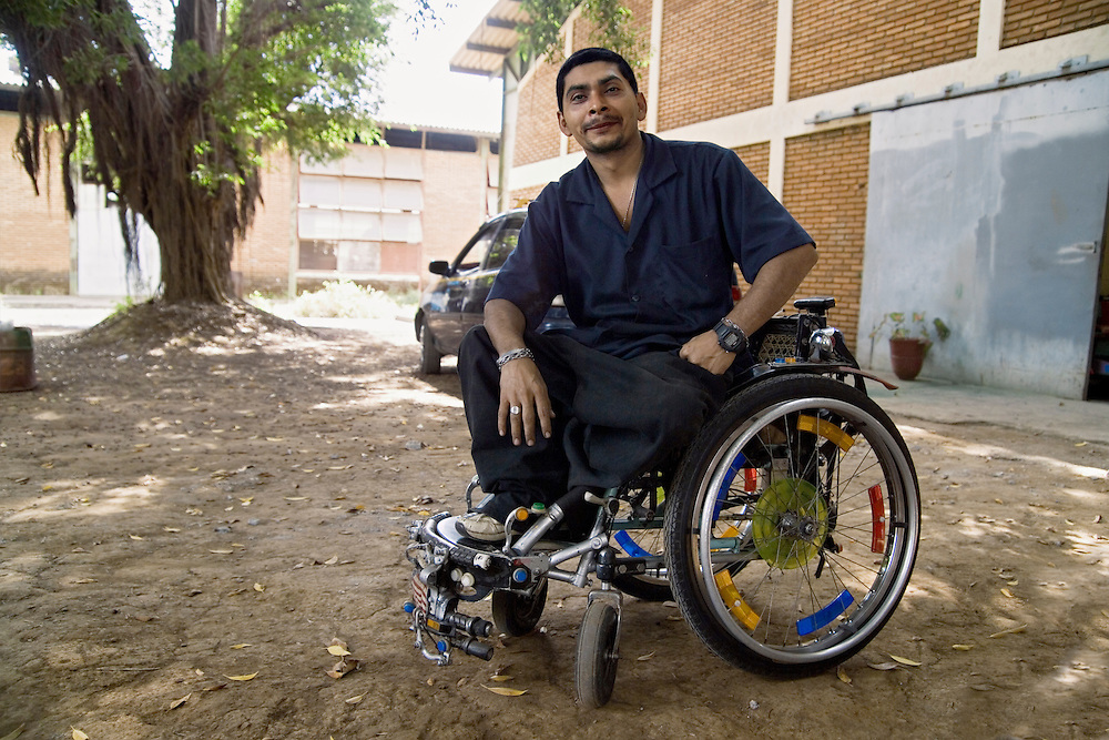 Enrique Medince Calderon in his customized wheelchair at the PLUSAA workshop in León, Nicaragua.