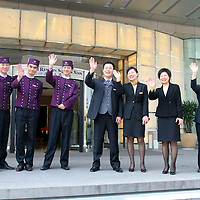 Asia, China, Shaanxi, Xian. A warm staff welcome at The Sofitel Hotel in Xian.