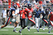 Ja-Mes Logan (85) is chased by Cody Prewitt (25) at Ole Miss' Grove Bowl at Vaught-Hemingway Stadium in Oxford, Miss. on Saturday, April 13, 2013.