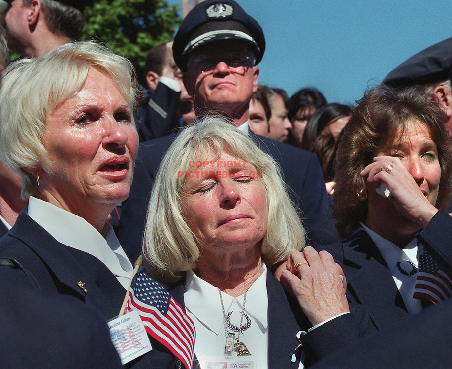 "fragm  ""Airline Employee Remebrance""  At City Hall Plaza-3 American Airlines Flight Attendants LTOR Bette Langlais,Mickey Bulger and Jan Johnson (all next door neighbors in Hampton,NH) cry during Bette Midler's song ""Wind Beneath My Wings"" at the service in memory of the 22 American and United Airlines employees  that died in flight hitting the WTC in NYC working on Sept 11 2001."