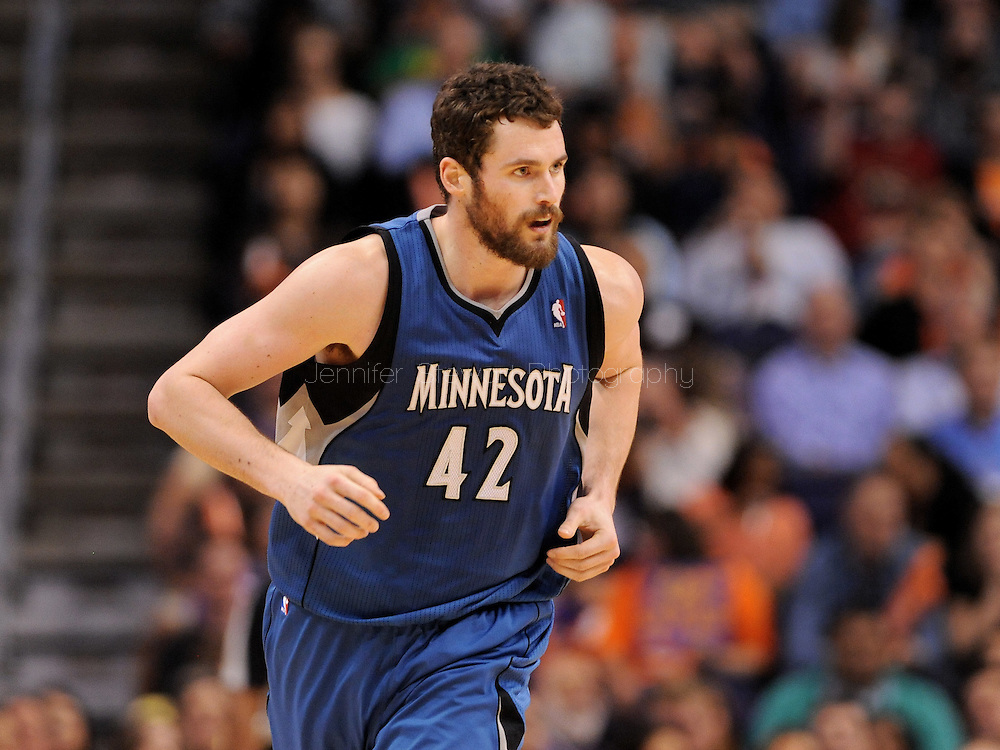 Mar. 12, 2012; Phoenix, AZ, USA;  Minnesota Timberwolves forward Kevin Love (42) reacts on the court while playing against the Phoenix Suns at the US Airways Center. The Timberwolves defeated the Suns 127-124.  Mandatory Credit: Jennifer Stewart-US PRESSWIRE.