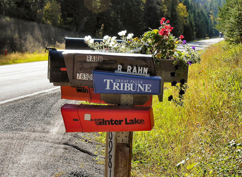A touch of art was added by having a flower pot attached to the mail boxes; otherwise it would have just been  an assembly of  boxes. Along a Montana byway.