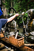 Throwing water on bronze Buddha statues.