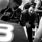 Salem Stampede coach Joe Becerra gives his team a pep talk before their first game, a March exhibition in Woodburn. Photographed March 24, 2006. (Thomas Patterson / Statesman Journal)