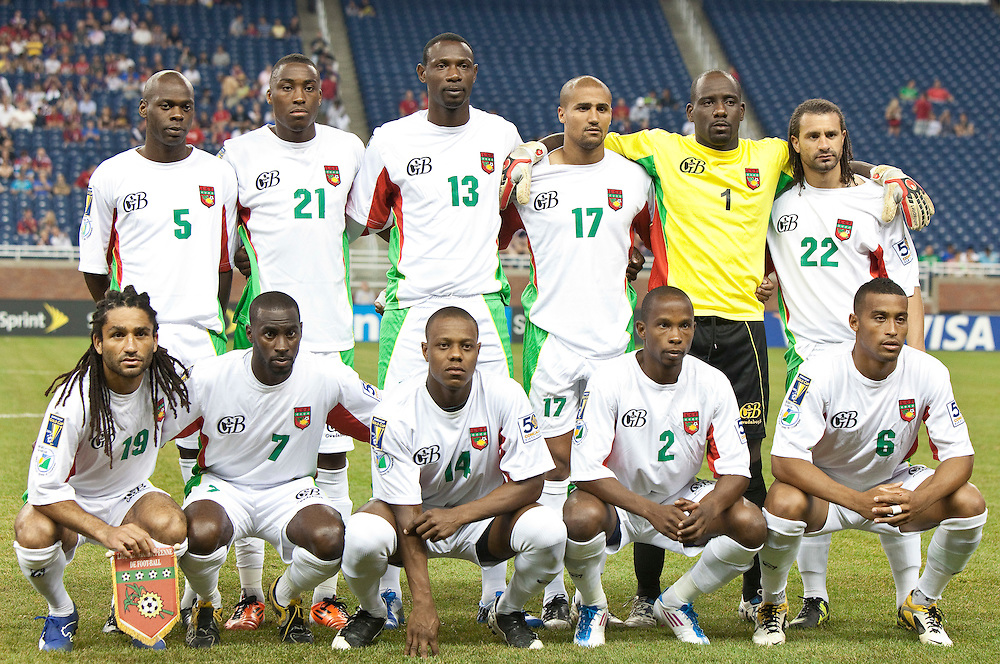 GR8001-20110607- Detroit, Ontario,Canada<br /> Guadeloupe poses for their team photo at the start of their CONCACAF match against Panama at Ford Field in Detroit Michigan, June 7, 2011.<br /> AFP PHOTO/Geoff Robins